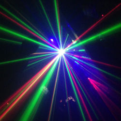 Several lasers and lights at a dance party