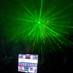 Green laser behind the DJ booth
